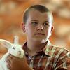 Trenton Hendrix shows his rabbit during the Livestock Auction at the Howard County 4-H Fair on Thursday, July 12, 2018.<br /> Kelly Lafferty Gerber | Kokomo Tribune