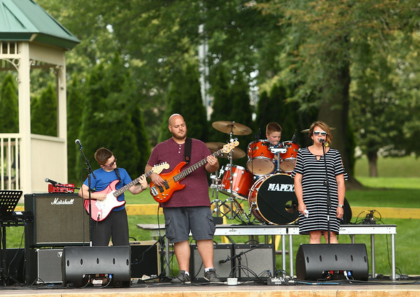 The Connolly family performs at RhumFest in Foster Park on Saturday, July 28, 2018.<br /> Kelly Lafferty Gerber | Kokomo Tribune