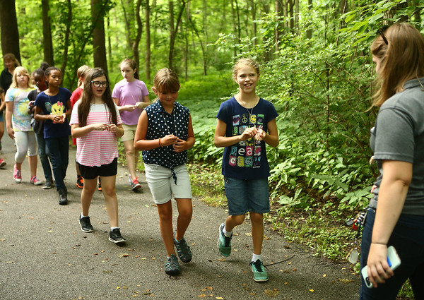 Day campers walk along a nature hike at Jackson Morrow Park during the Super Explorers day camp on Monday, July 16, 2018.<br /> Kelly Lafferty Gerber | Kokomo Tribune