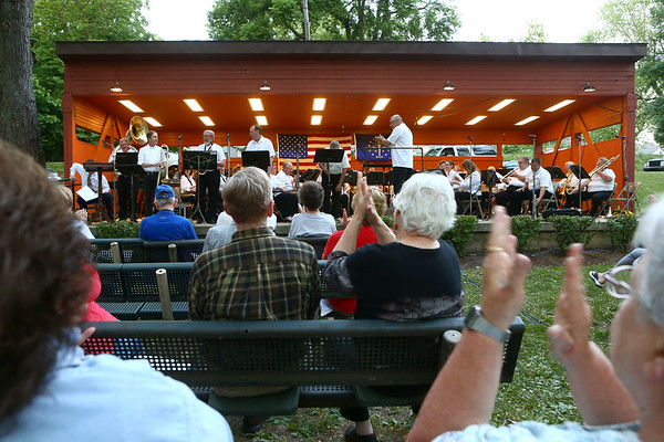 """The audience applauds as the Retired Rum-Runners Traditional Jazz Band, along with the Kokomo Park Band, play """"Sweet Georgia Brown"""" during their season opener at Highland Park on Wednesday, June 6, 2018.<br /> Kelly Lafferty Gerber   Kokomo Tribune"""