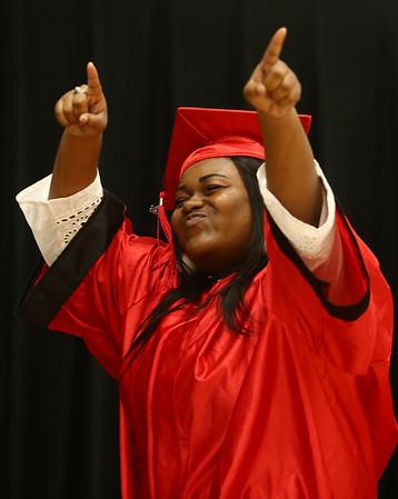 KiArrah Monteiro celebrates as she walks across the stage during the Taylor High School graduation on Friday, June 8, 2018.<br /> Kelly Lafferty Gerber   Kokomo Tribune