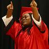 KiArrah Monteiro celebrates as she walks across the stage during the Taylor High School graduation on Friday, June 8, 2018.<br /> Kelly Lafferty Gerber | Kokomo Tribune