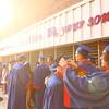 Jacob Ashburn, right, fixes the cap of a fellow classmate outside of Memorial Gym before the start of the Kokomo High School 2018 graduation on Friday, June 1, 2018.<br /> Kelly Lafferty Gerber | Kokomo Tribune