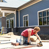 Randy Johns, from Lybrook Landscaping, lays bricks in front of the Kokomo Humane Society on June 28, 2018.<br /> Kelly Lafferty Gerber | Kokomo Tribune