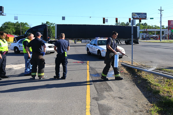 Kokomo fire fighters do final cleanup after a fatal accident at US931 and Ind 26 on Monday morning June 4, 2018. A pedestrian was crossing 931 when they were hit by a truck about 6 a.m.<br /> Tim Bath | Kokomo Tribune