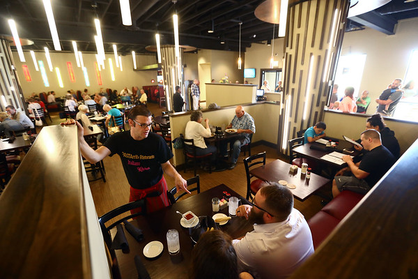 Jared Green, who has been a server at PASTArrific for eight years, talks to customers at PASTArrific on Tuesday, June 12, 2018. The Italian restaurant reopened after a devastating fire over a year ago.<br /> Kelly Lafferty Gerber   Kokomo Tribune