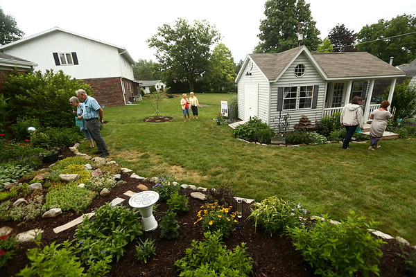 People check out the backyard of Jack and Carol Reed's garden during the Garden Stroll on Saturday, June 23, 2018.<br /> Kelly Lafferty Gerber | Kokomo Tribune