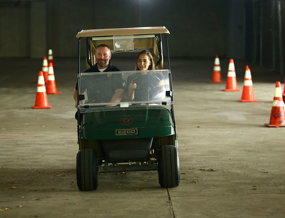 Mariah Walsh, 14, accompanied by IUK police officer Brian Hunt, makes her way through the cones during a driving course at Kokomo Police Department's youth academy on Wednesday, June 20, 2018.<br /> Kelly Lafferty Gerber | Kokomo Tribune