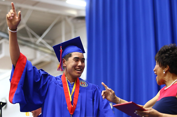 """Ryan Ziliotto holds up his pointer finger as he says """"last one,"""" after being the final Kokomo High School 2018 graduate to cross the stage on Friday, June 1, 2018.<br /> Kelly Lafferty Gerber   Kokomo Tribune"""