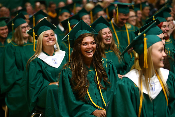 Allison Hanner laughs as she listens to Eastern High School teacher Peter Heck give the commencement address during Eastern's graduation on Sunday, June 3, 2018.<br /> Kelly Lafferty Gerber | Kokomo Tribune