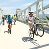 Bikers hit the trail and cross the bridge after the Nickel Plate trail bridge was officially opened on Friday, June 29, 2018.<br /> Kelly Lafferty Gerber | Kokomo Tribune