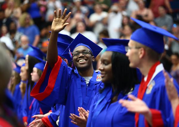 Malcolm Williams waves into the audience at Memorial Gym during the Kokomo High School 2018 graduation on Friday, June 1, 2018.<br /> Kelly Lafferty Gerber | Kokomo Tribune