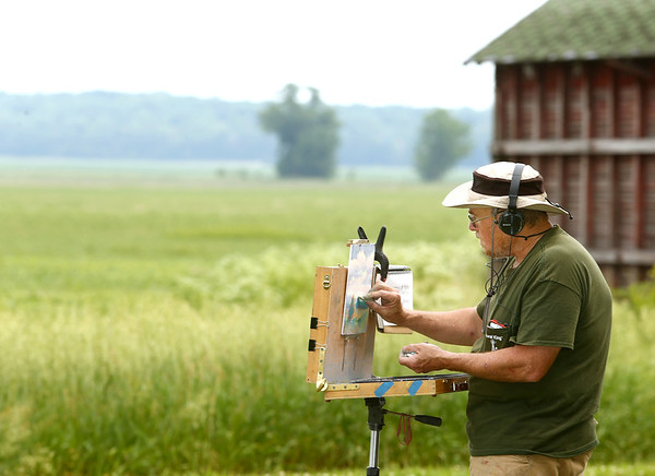 Avon Waters, using the landscape of Richvalley, located in Wabash County, for inspiration, uses pastels to paint a rural scene off the side of the road on June 8.<br /> Kelly Lafferty Gerber   Kokomo Tribune