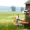 Avon Waters, using the landscape of Richvalley, located in Wabash County, for inspiration, uses pastels to paint a rural scene off the side of the road on June 8.<br /> Kelly Lafferty Gerber | Kokomo Tribune