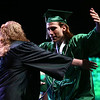 Kyle Williams goes in for a hug as he receives his Excel Center diploma at graduation on Thursday, June 14, 2018.<br /> Kelly Lafferty Gerber | Kokomo Tribune