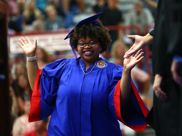 Keaira Fowler poses as she crosses the stage during the Kokomo High School 2018 graduation on Friday, June 1, 2018.<br /> Kelly Lafferty Gerber | Kokomo Tribune