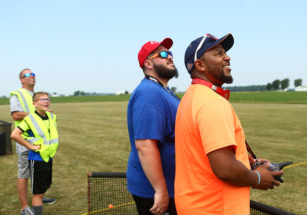 Ali Abdulrasheed, right, from Indianapolis, and Scott Carpenter, from Kokomo, watch Abdulrasheed's plane as he aims to drop an egg as close as he can to the target during the Converse Flying Eagles R/C Club's annual egg drop at the Converse Airport on Saturday, June 16, 2018.<br /> Kelly Lafferty Gerber   Kokomo Tribune
