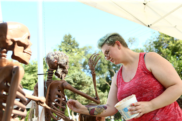Brittany Pyle uses cotton balls and liquid latex to make decaying flesh as part of the Edge of Insanity table during the Maker City Fair at the Haynes Apperson Festival on Friday, June 29, 2018.<br /> Kelly Lafferty Gerber | Kokomo Tribune