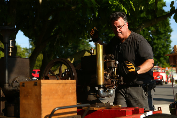 Mike Kessler gets his cellphone charged 1929 International Harvester McCormick Deering going during the Maker City Fair at the Haynes Apperson Festival on Friday, June 29, 2018.<br /> Kelly Lafferty Gerber   Kokomo Tribune