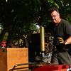Mike Kessler gets his cellphone charged 1929 International Harvester McCormick Deering going during the Maker City Fair at the Haynes Apperson Festival on Friday, June 29, 2018.<br /> Kelly Lafferty Gerber | Kokomo Tribune