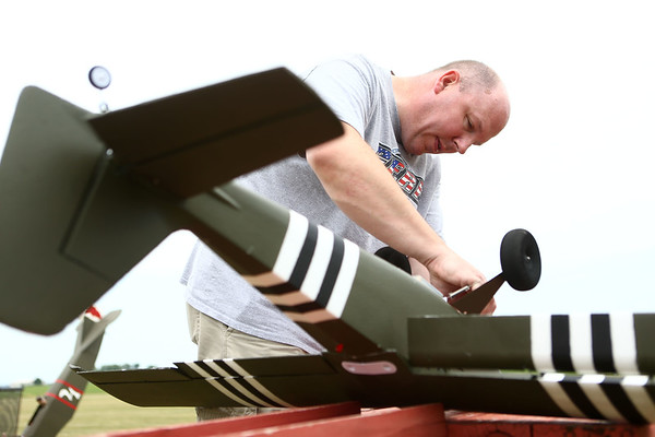 Scott Wells, of New Palestine, prepares his radio control plane for flight as the Converse Flying Eagles R/C Club met at the Converse Airport for the annual egg drop competition on Saturday, June 16, 2018.<br /> Kelly Lafferty Gerber | Kokomo Tribune