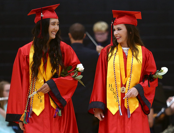 Ruth Durham, left, and Presleigh Oger walk in to the gym together during Taylor High School's graduation on Friday, June 8, 2018.<br /> Kelly Lafferty Gerber | Kokomo Tribune