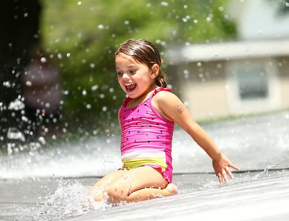 Laila Larmer, 4, slides down the tarp during the water spray at Highland Park on Wednesday, June 27, 2018.<br /> Kelly Lafferty Gerber   Kokomo Tribune