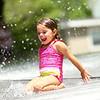 Laila Larmer, 4, slides down the tarp during the water spray at Highland Park on Wednesday, June 27, 2018.<br /> Kelly Lafferty Gerber | Kokomo Tribune