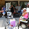 Tina Robinson, left, owner of Junk 'n Java, surprised customer Tami Miscoi with a new bike on Friday, June 15. Robinson bought the bike from Schwinn after donations poured in on Facebook.<br /> Kelly Lafferty Gerber | Kokomo Tribune