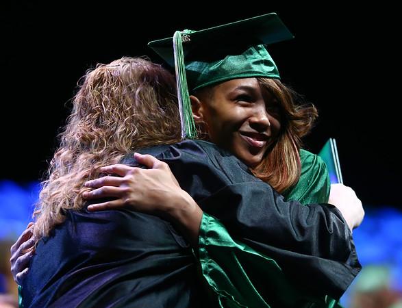 Lagregria Hardimon hugs Martha Warner as Hardimon crosses the stage during the Excel Center graduation on Thursday, June 14, 2018.<br /> Kelly Lafferty Gerber | Kokomo Tribune