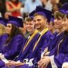 Bryce Cunninghman, center, laughs as he listens to a speech during Northwestern High School's 2018 graduation on Saturday, June 2, 2018.<br /> Kelly Lafferty Gerber | Kokomo Tribune
