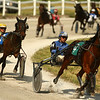 Rose Run Untouched, with rider Mike Hollenback, leads the pack as they race around the track during harness racing at the Converse Fair on Thursday, June 7, 2018.<br /> Kelly Lafferty Gerber | Kokomo Tribune