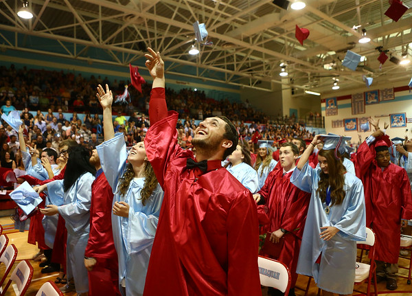 Robert Dunham tosses his cap in the air after being officially declared a graduate of Maconaquah High School during their graduation ceremony on Saturday, June 2, 2018.<br /> Kelly Lafferty Gerber | Kokomo Tribune