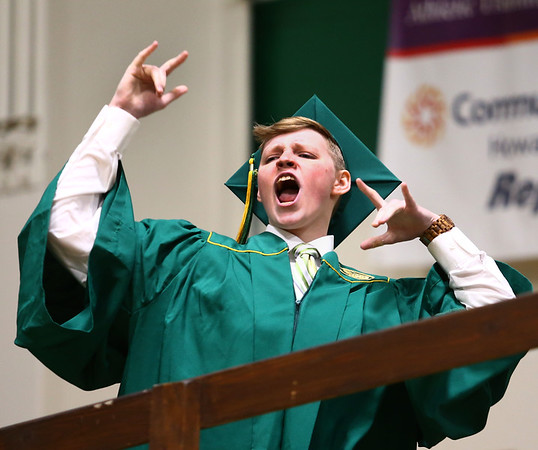Kelic Davidson celebrates while crossing the stage during the Eastern High School graduation on Sunday, June 3, 2018.<br /> Kelly Lafferty Gerber | Kokomo Tribune