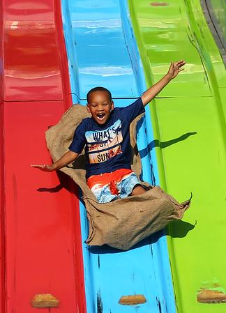 Deshawn Green, 5, takes a ride on the Super Slide during the Haynes Apperson Festival on Thursday, June 28, 2018.<br /> Kelly Lafferty Gerber   Kokomo Tribune
