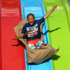 Deshawn Green, 5, takes a ride on the Super Slide during the Haynes Apperson Festival on Thursday, June 28, 2018.<br /> Kelly Lafferty Gerber | Kokomo Tribune