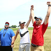 25-year-old Kaleb Worl, right, on leave from the Air Force, reacts after he's announced as the egg drop winner during the Converse Flying Eagles R/C Club's annual competition at the Converse Airport on Saturday, June 16, 2018. Using a radio control, pilots flew their planes with an egg in tow, in hopes of dropping it at the right spot for it to land close to the target on the ground.<br /> Kelly Lafferty Gerber | Kokomo Tribune