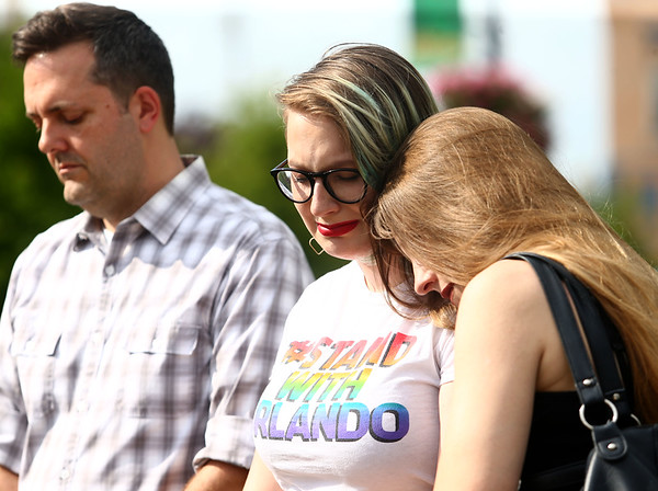 """Amy Ruckman rests her head on her daughter's shoulder, 15-year-old Hannah Ruckman, during 58 seconds of silence to honor those killed in the Florida nightclub and South Carolina church shootings. The Ruckmans were part of the """"Disarm Hate Vigil"""" at the Howard County Courthouse on Tuesday, June 12, 2018.<br /> Kelly Lafferty Gerber 