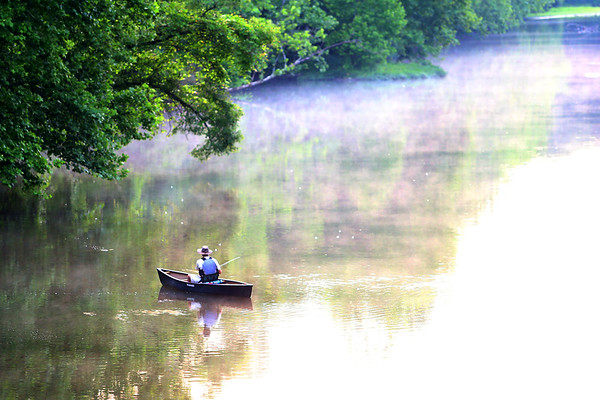 A man fishes the Wildcat Creek just east of 300 West in the early morning hours on June 7, 2018.<br /> Tim Bath   Kokomo Tribune
