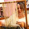 Annie Lightsey weaves on a framed loom during the Maker City Fair at the Haynes Apperson Festival on Friday, June 29, 2018.<br /> Kelly Lafferty Gerber | Kokomo Tribune