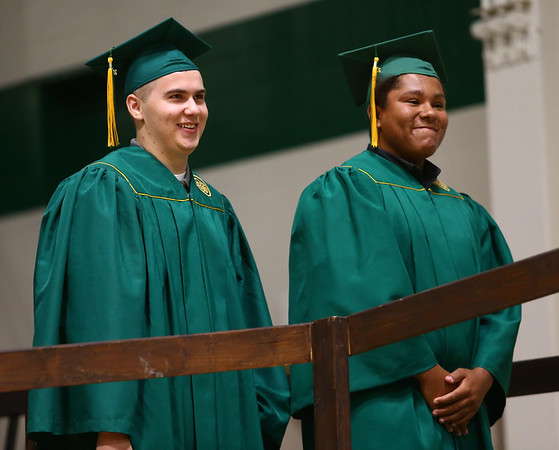 Tyler Hurtson, right, and Gavin James smile as they wait to cross the stage during Eastern High School's graduation on Sunday, June 3, 2018.<br /> Kelly Lafferty Gerber | Kokomo Tribune