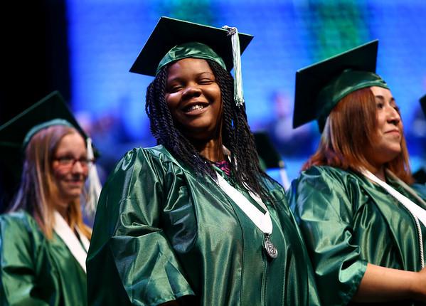 Yardra Gordon grins after turning her tassel marking her a graduate of the Excel Center on Thursday, June 14, 2018.<br /> Kelly Lafferty Gerber   Kokomo Tribune