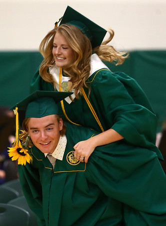 Andrea Larson hops on Isaac Beachy's back as they piggyback during the Eastern High School graduation procession on Sunday, June 3, 2018.<br /> Kelly Lafferty Gerber   Kokomo Tribune