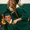 Andrea Larson hops on Isaac Beachy's back as they piggyback during the Eastern High School graduation procession on Sunday, June 3, 2018.<br /> Kelly Lafferty Gerber | Kokomo Tribune