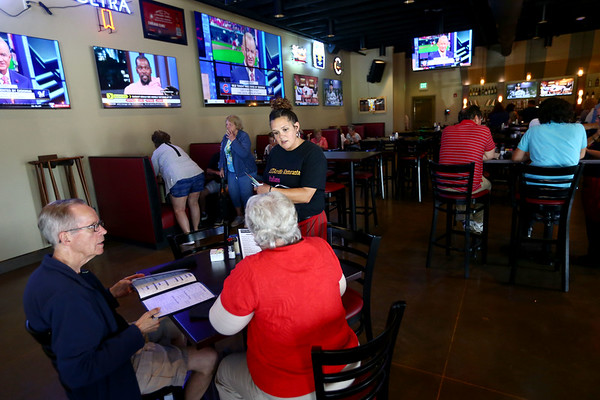 Ashleigh Jordan takes a drink order in the pub room at PASTArrific on Tuesday, June 12, 2018. The Italian restaurant reopened after a devastating fire over a year ago.<br /> Kelly Lafferty Gerber | Kokomo Tribune