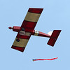 An egg attached to a red streamer drops from a radio control plane in hopes of landing near the target as the Converse Flying Eagles R/C Club met at the Converse Airport for the annual egg drop competition on Saturday, June 16, 2018.<br /> Kelly Lafferty Gerber | Kokomo Tribune