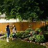 Patty Zeck, left, and Joan Strawhacker chat in Jack and Carol Reed's backyard during the Garden Stroll on Saturday, June 23, 2018.<br /> Kelly Lafferty Gerber | Kokomo Tribune