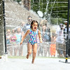 Harley Harrington, 6, runs through the water spray at Highland Park on Wednesday, June 27, 2018.<br /> Kelly Lafferty Gerber | Kokomo Tribune