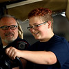 Jaren Deck, 13, with the assistance of IUK chief of police Thomas Remender, tries his hand at driving the golf cart through the course at Kokomo Police Department's youth academy on Wednesday, June 20, 2018.<br /> Kelly Lafferty Gerber | Kokomo Tribune