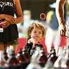 3-year-old Alekai Williams tries his hand at the ring-a-bottle game during the Haynes Apperson Festival on Thursday, June 28, 2018.<br /> Kelly Lafferty Gerber | Kokomo Tribune